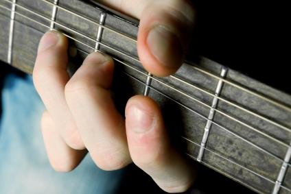 boy learning guitar chords